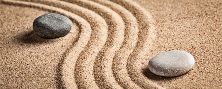 Japanese Zen stone garden - relaxation, meditation, simplicity and balance concept  - letterbox panorama of pebbles and raked sand tranquil calm scene Stock Photo