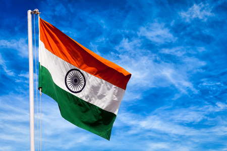 India symbol indian flag against blue sky Imagens