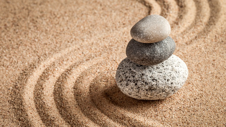 tranquil: Japanese Zen stone garden - relaxation, meditation, simplicity and balance concept  - panorama of pebbles and raked sand tranquil calm scene Stock Photo