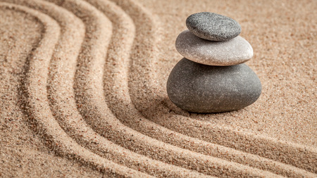 Japanese Zen stone garden - relaxation, meditation, simplicity and balance concept  - panorama of pebbles and raked sand tranquil calm scene 스톡 콘텐츠
