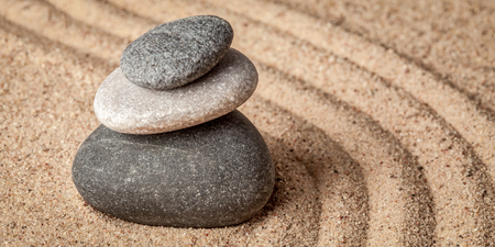 zen: Japanese Zen stone garden - relaxation, meditation, simplicity and balance concept  - letterbox panorama of pebbles and raked sand tranquil calm scene Stock Photo