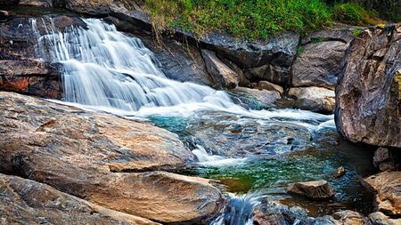 cascade: Panorama of waterfall cascade shot with long exposure Stock Photo