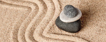 raked: Japanese Zen stone garden - relaxation, meditation, simplicity and balance concept  - letterbox panorama of pebbles and raked sand tranquil calm scene Stock Photo