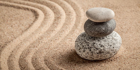 meditative: Japanese Zen stone garden - relaxation, meditation, simplicity and balance concept  - letterbox panorama of pebbles and raked sand tranquil calm scene Stock Photo