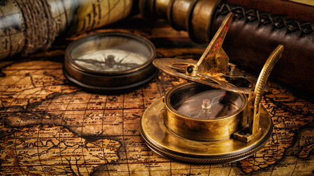 sonnenuhr: Travel geography navigation concept background - panorama of old vintage retro compass with sundial, spyglass and rope on ancient world map Lizenzfreie Bilder