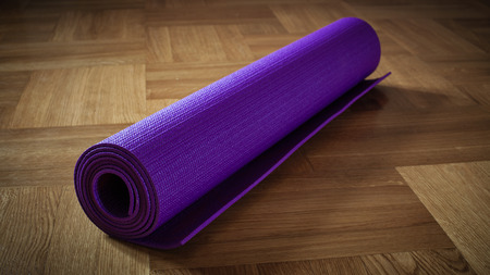 Yoga background banner - panoramic image of yoga mat on wooden floor Stock Photo