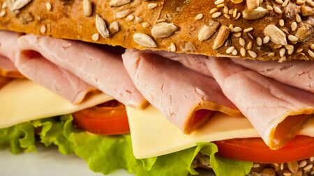 ham sandwich: Panorama of ham sandwich with lettuce, cheese, tomato close up