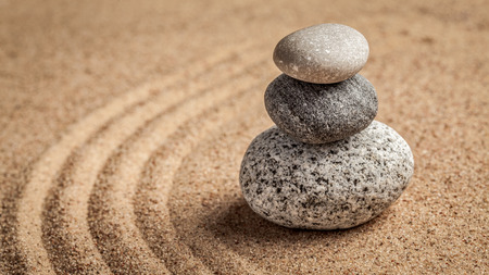 raked: Japanese Zen stone garden - relaxation, meditation, simplicity and balance concept  - panorama of pebbles and raked sand tranquil calm scene Stock Photo