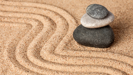 zen stone: Japanese Zen stone garden - relaxation, meditation, simplicity and balance concept  - panorama of pebbles and raked sand tranquil calm scene Stock Photo