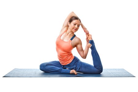 eka: Sporty fit yogini woman doing yoga asana Eka pada kapotasana - one-legged pigeon pose isolated on white