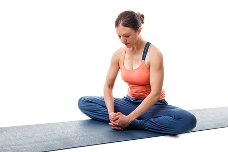 baddha: Beautiful sporty fit woman practices yoga asana Baddha konasana - bound angle pose isolated on white