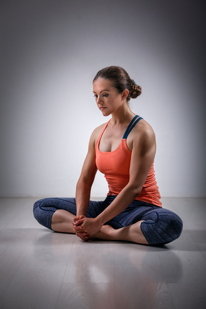 hatha: Beautiful sporty fit woman practices yoga asana Baddha konasana - bound angle pose Stock Photo