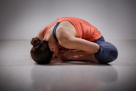 asana: Beautiful sporty fit woman practices yoga asana Baddha konasana - bound angle pose Stock Photo