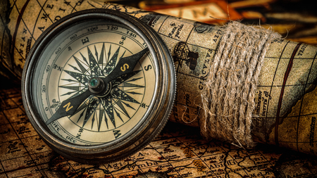 sun dial: Travel geography navigation concept background - panorama of old vintage retro compass on ancient world map
