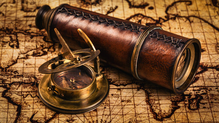 old vintage: Travel geography navigation concept background - panorama of old vintage retro compass with sundial and spyglass on ancient world map Stock Photo