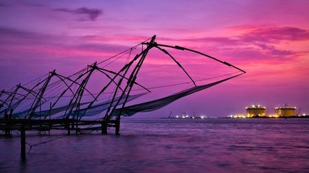 fishing nets: Panorama of Kochi tourist attraction - chinese fishnets on sunset with grunge texture overlaid. Fort Kochin, Kochi, Kerala, India