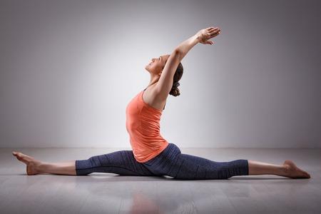hatha: Sporty fit woman doing Hatha yoga asana Hanumanasana  (splits) - monkey pose