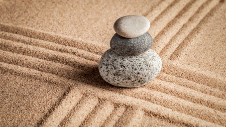 Japanese Zen stone garden - relaxation, meditation, simplicity and balance concept  - panorama of pebbles and raked sand tranquil calm scene Stock Photo