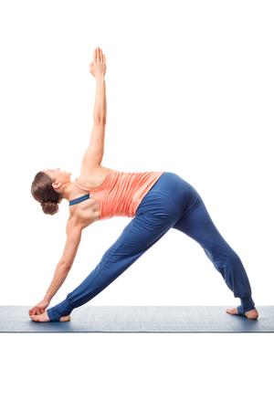 ashtanga: Young fit woman doing Ashtanga Vinyasa Yoga asana utthita trikonasana - extended triangle pose view from back ashtanga-vinyasa style