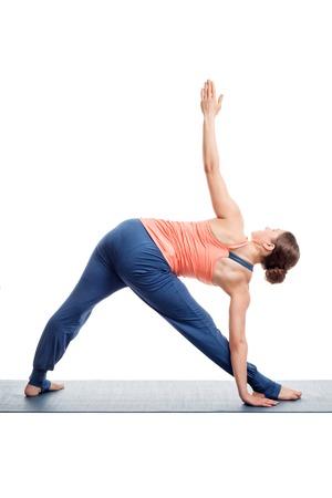 ashtanga: Sporty fit woman practices Ashtanga Vinyasa yoga asana utthita trikonasana - extended triangle pose view from back isolated on white
