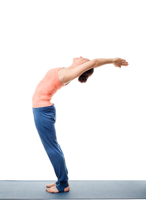 namaskar: Beautiful sporty fit woman practices Sivananmda yoga asana Anuvittasana  - standing back bend pose isolated on white Stock Photo