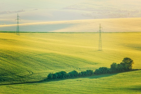 power line tower: Vintage retro effect filtered hipster style image of Moravian summer rolling landcsape with two power line tower. Moravia, Czech Republic