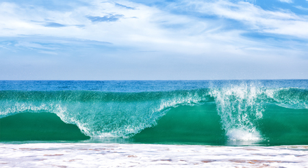 flux: Big wave in ocean with blue sky, panoramic image
