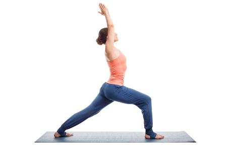 yogini: Beautiful sporty fit yogini woman practices yoga asana Virabhadrasana 1 - warrior pose 1 isolated on white Stock Photo