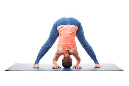 legged: Beautiful sporty fit woman practices Ashtanga Vinyasa yoga asana Prasarita padottanasana A - wide legged forward bend A isolated on white background