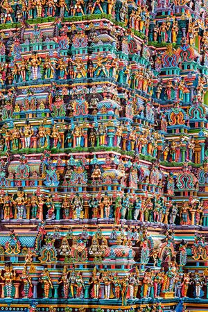 temple tower: Hindu temple gopura (tower) with statues of deities close up. Menakshi Temple, Madurai, Tamil Nadu, India