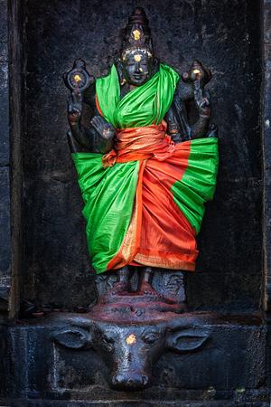 mahishasura: Durga (Mahisaurmardini) image. Airavatesvara Temple, Darasuram, Tamil Nadu, India. One of Great Living Chola Temples