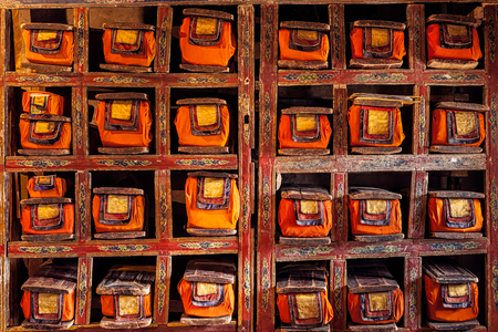 manuscripts: Folios of old manuscripts in library of Thiksey Gompa (Tibetan Buddhist Monastery). Ladakh, India Stock Photo