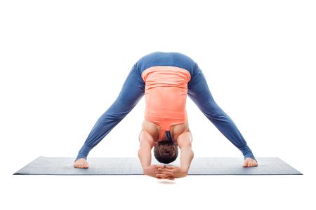 to bend: Beautiful sporty fit woman practices Ashtanga Vinyasa yoga asana Prasarita padottanasana C - wide legged forward bend C isolated on white background Stock Photo