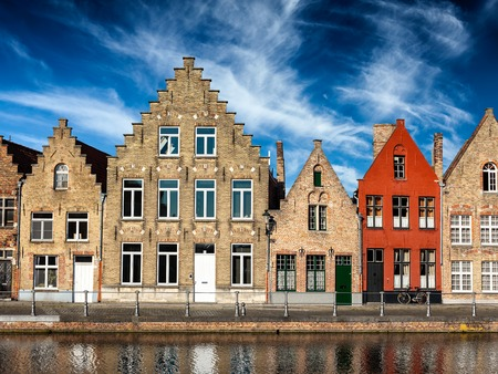 old houses: Old houses and canal in Bruges (Brugge) on sunset, Belgium Stock Photo