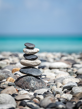 meditation: Zen meditation relaxation concept background -  balanced stones stack close up on sea beach