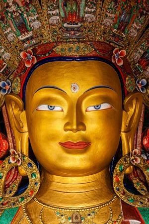 maitreya: Maitreya Buddha statue face close up in Thiksey Gompa. Ladakh, India