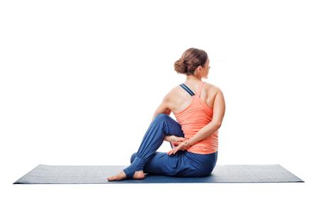 ardha: Beautiful sporty fit woman practices yoga asana  Ardha matsyendrasana - half spinal twist pose isolated on white Stock Photo