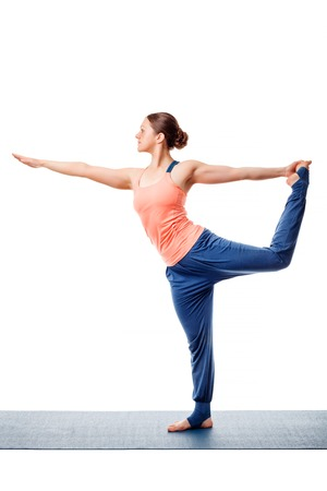 nataraja: Beautiful sporty fit woman doing yoga asana Natarajasana - Lord of the dance pose isolated on white
