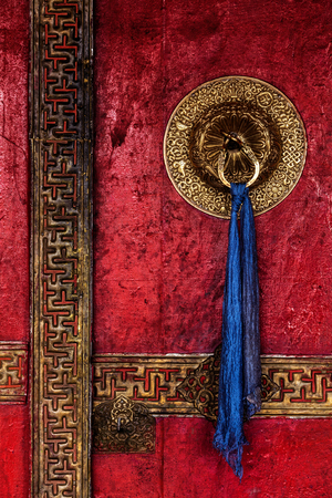 gompa: Gate of Spituk Gompa (Tibetan Buddhist monastery) with ornamented decorated door handle. Ladakh, India