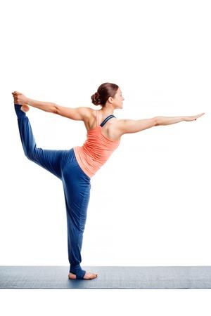 hatha: Beautiful sporty fit woman doing yoga asana Natarajasana - Lord of the dance pose isolated on white