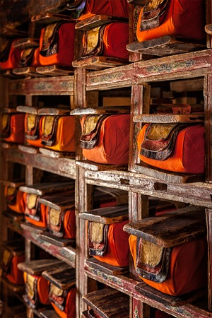 Folios of old manuscripts in library of Thiksey Gompa (Tibetan Buddhist Monastery). Ladakh, India Stock Photo