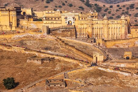 amber fort: Famous Indian tourist destination landmark Amer (Amber) fort with tourists riding elephants , Rajasthan, India