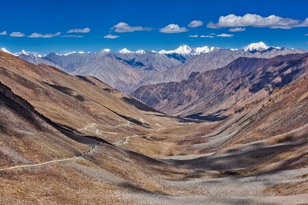 la: View of Karakorum range and road in valley  from Kardung La - the highest motorable pass in the world (5602 m). Ladakh, India