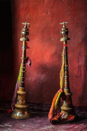 religious building: Buddhist prayer horns, Spituk Gompa (Tibetan Buddhist monastery). Ladakh, Jammu and Kashmir, India Stock Photo