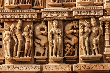 sculpture: Stone carving bas relief sculptures on Adinath Jain Temple, famous indian tourist site Khajuraho, Madhya Pradesh, India