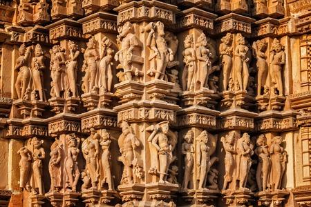 madhya pradesh: Stone carving bas relief sculptures on Vaman Temple, famous indian tourist site Khajuraho, Madhya Pradesh, India
