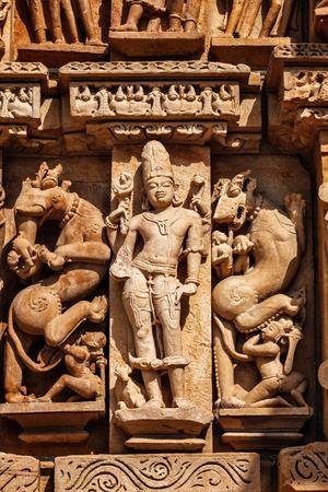 jainism: Stone carving bas relief sculptures on Vaman Temple, famous indian tourist site Khajuraho, Madhya Pradesh, India