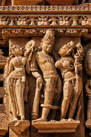 bas relief: Stone carving bas relief sculptures on Vaman Temple, famous indian tourist site Khajuraho, Madhya Pradesh, India