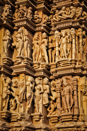 pradesh: Stone carving bas relief sculptures on Vaman Temple, famous indian tourist site Khajuraho, Madhya Pradesh, India