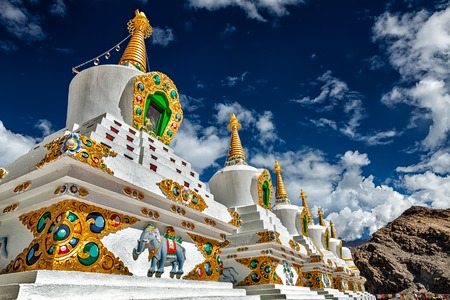 gompa: White chortens (Buddhist stupas) in Thiksey gompa. Ladakh, Jammu and Kashmir, India